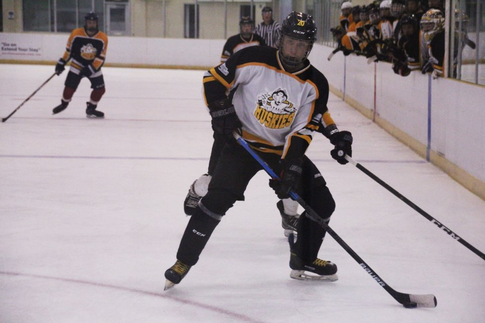 Nathan Brownlee keeps the puck in the zone during Fort St. John Huskies camp, August 28.