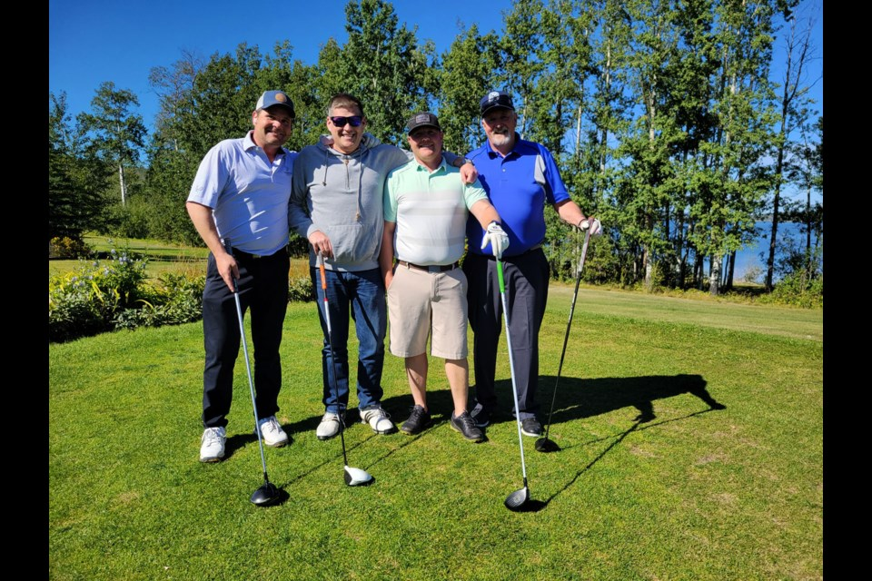 From left: Jason Atkins, Shawn Ward, Blair Wandler and Cam Allen tee off to start the long-awaited 58th Annual Oilmen's Golf Tournament at Lakepoint, September 2, 2021. This year's event was a one-day scramble instead of the traditional three-day format.