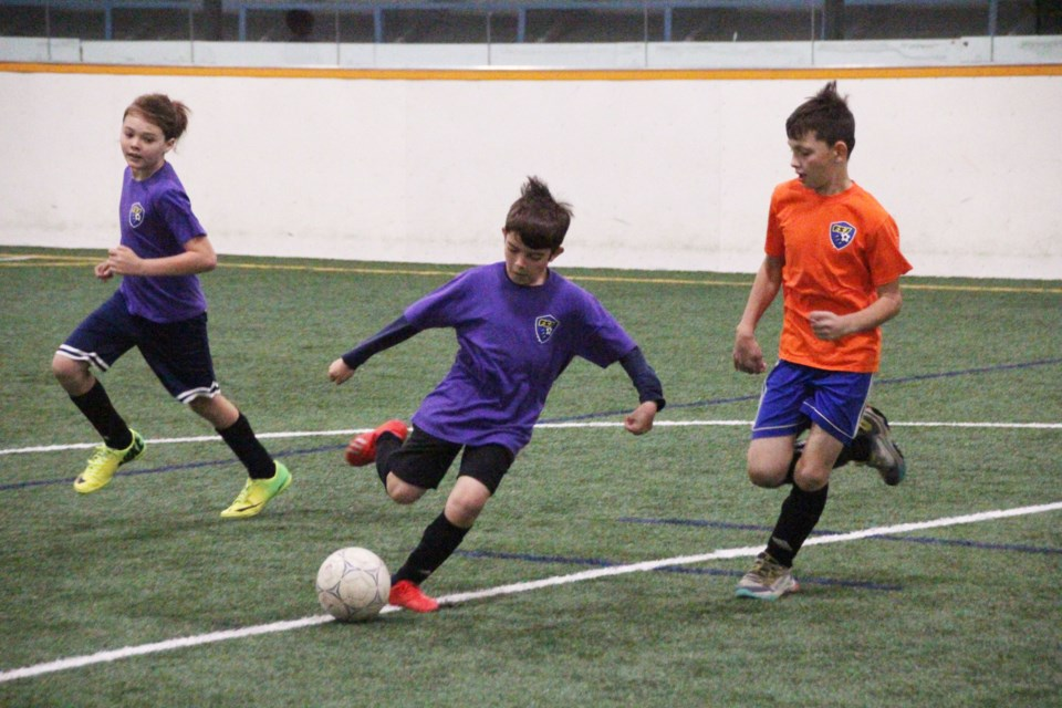 Mateo Garcia Paredes boots the ball upfield during a U11 game at the FSJ Soccer Club Icebreaker, September 25, 2021.