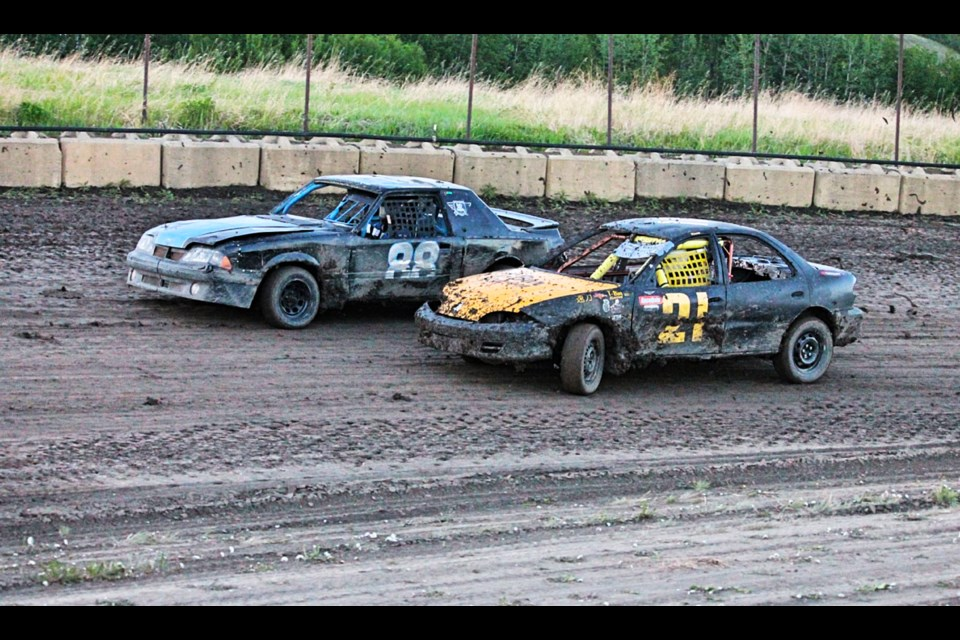 Eddie Scarfo (88) and Cody Willis (21) battle it out during the Mini Stock Juniors main event on June 12. Willis would finish first, with Scarfo making the podium in third.