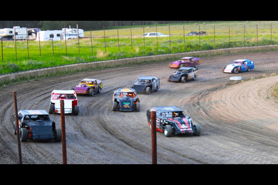 Dean Bell, 58, takes the corner in first during IMCA Modifieds action at Taylor Speedway, July 9. He had two second place finishes on the weekend.