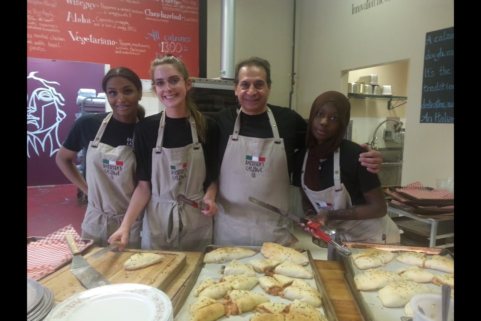 (L-R) Battista's Calzone Co. staff Meika Demers, Vecchio's goddaughter Gabrielle, Battista Vecchio and Reimaz Mohamed. Photo: Lucy Haines