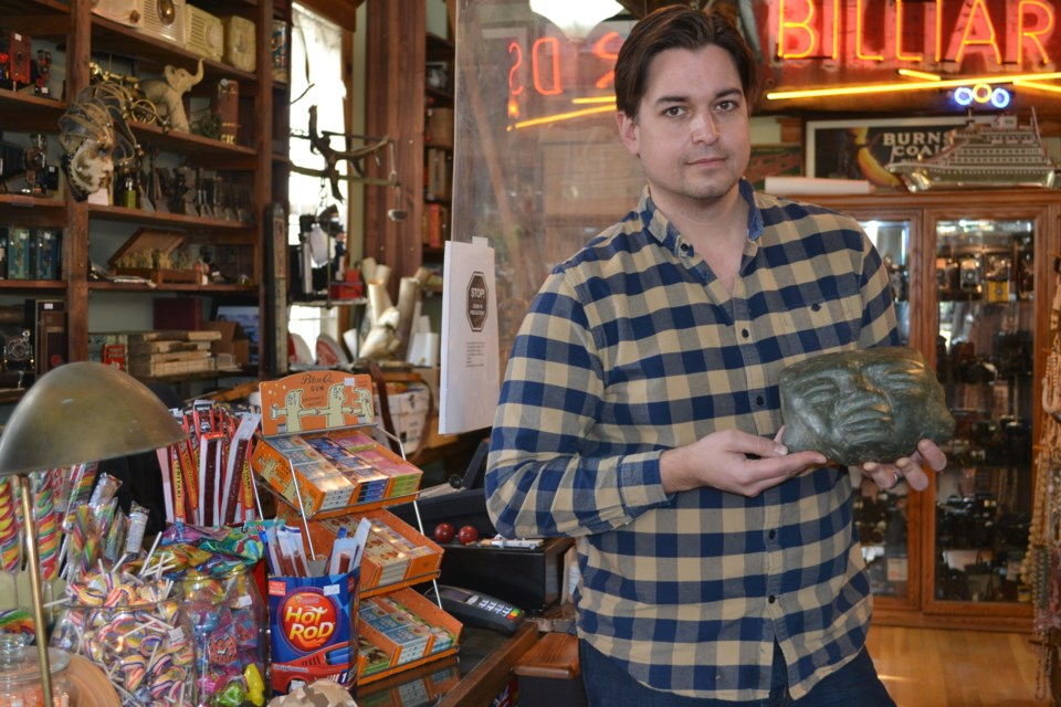 Alex Archbold holds an ancient Mayan jade mask, dating back possibly between the Ice Age and 500 CE. Photo: Lucy Haines