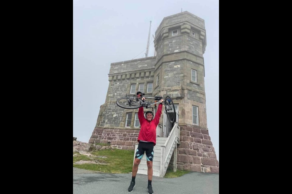 Edmonton's Tom Walsh, 63, celebrates the completion of his cross-Canada ride at Signal Hill in St. John's, Newfoundland in early September. Photo submitted.