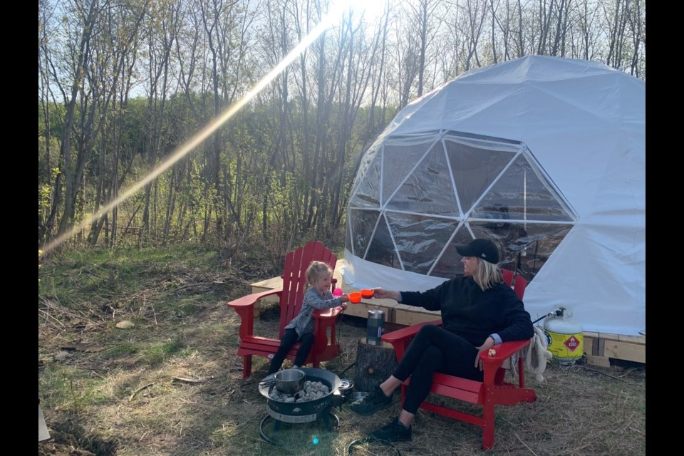 Marion Pilz and daughter Leni, three, spent their first night glamping on an island in Edmonton's River Valley. Steve Capp of Urban River Adventures offers the unique camping experience, taking guests by jet boat on the North Saskatchewan River upriver from Laurier Park.  Photo submitted