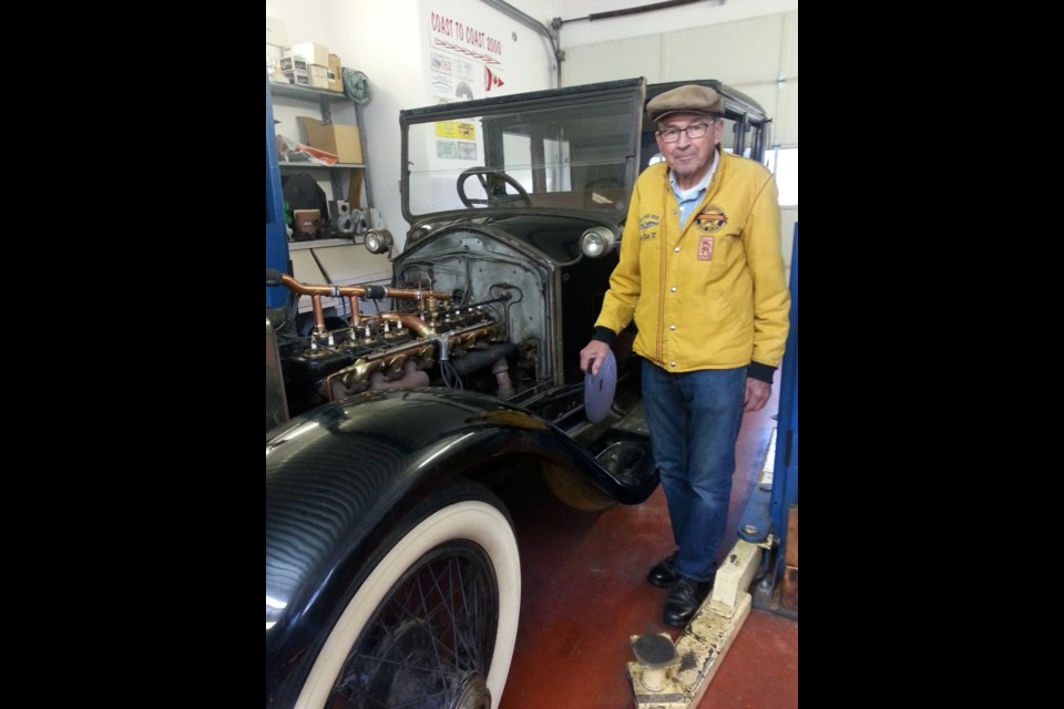 Howard Lengert has the largest collection of Rolls Royce and Bentleys in Canada. He's working on one of the oldest in the collection now. Photo Lucy Haines