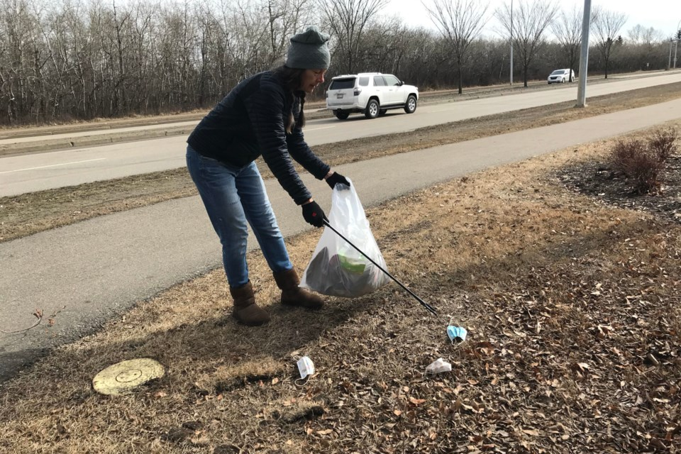 Linda Poignant picks up masks in the Westboro neighbourhood of Sherwood Park on March 27.