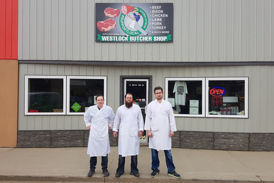 The owners of the Westlock Butcher Shop Ben Lanouette, left, Paul Lanouette and Coleby Woodcock stand in front of the popular outlet. (Photo supplied)