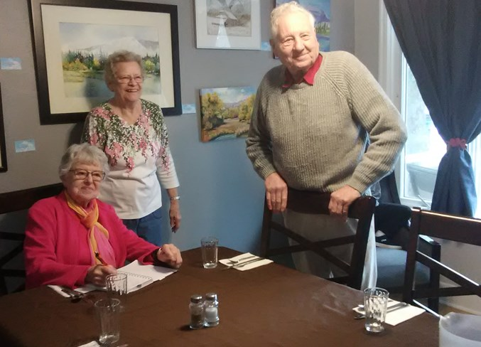 Charlotte Kochan, SCONA president (seated), gets some business done with members Eilene Shuflita and Al Vickery.