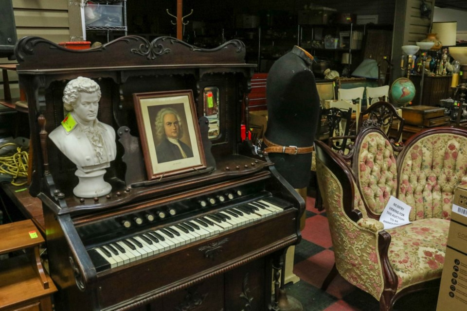 The estate auctions of Madame Rac's belongings included thousands of vintage items, like a sofa/settee, organ and busts. Photo submitted by Kastner Auctions