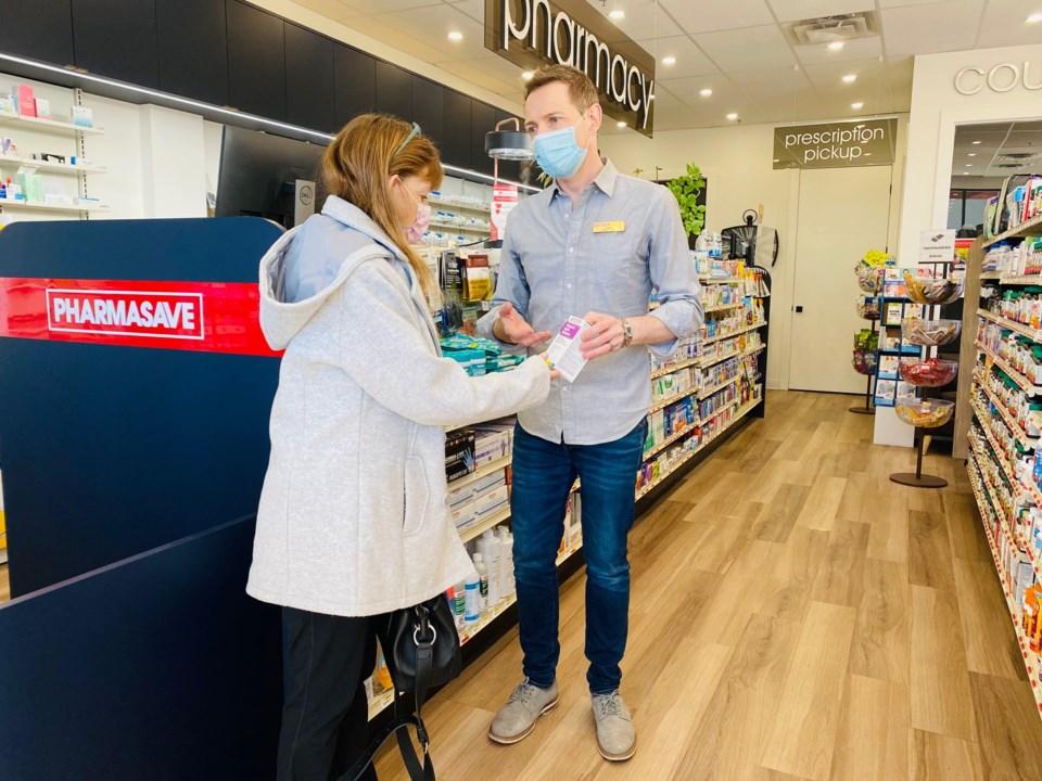 Pharmasave Jason Chan Remillard with Customer