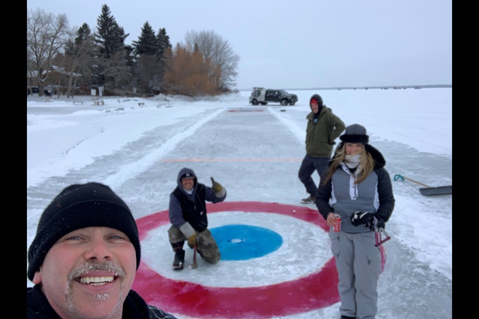 Corey Kozack, left, takes a selfie with fellow Pigeon Lake curling rink creators, Darcie Carey, Paul McLeod and Shelly Sinclair. Photos submitted.