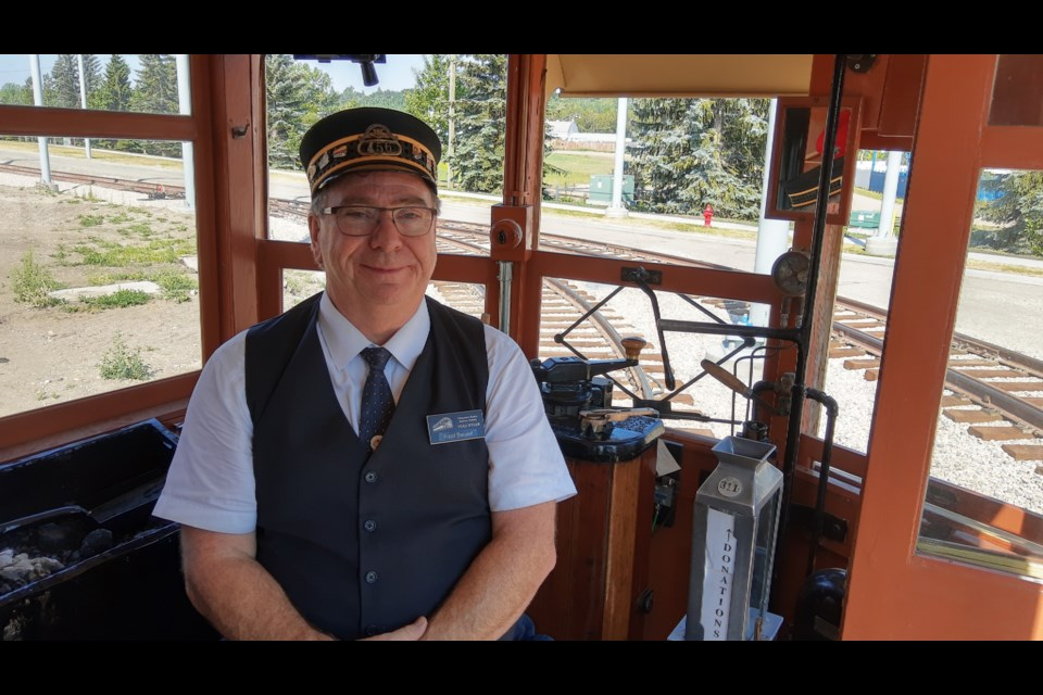 Volunteer Ward Baskett guides his streetcar around Fort Edmonton Park. Service resumed at the park and across the High Level Bridge line in July. Photo: Terry Jorden