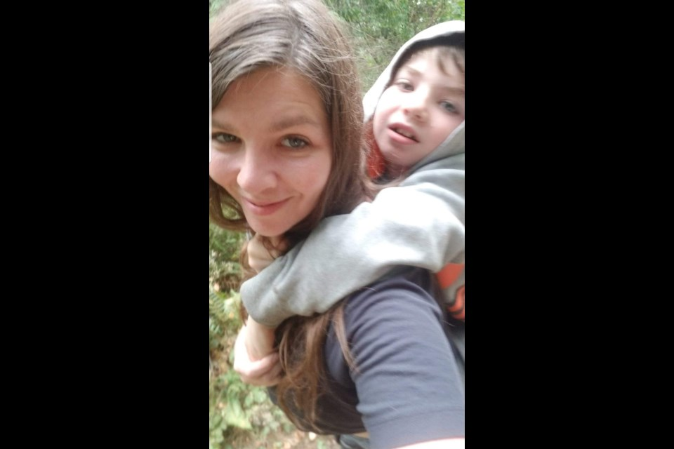Melody Shapiro takes her son, Davi, for a piggy back ride. Photo submitted