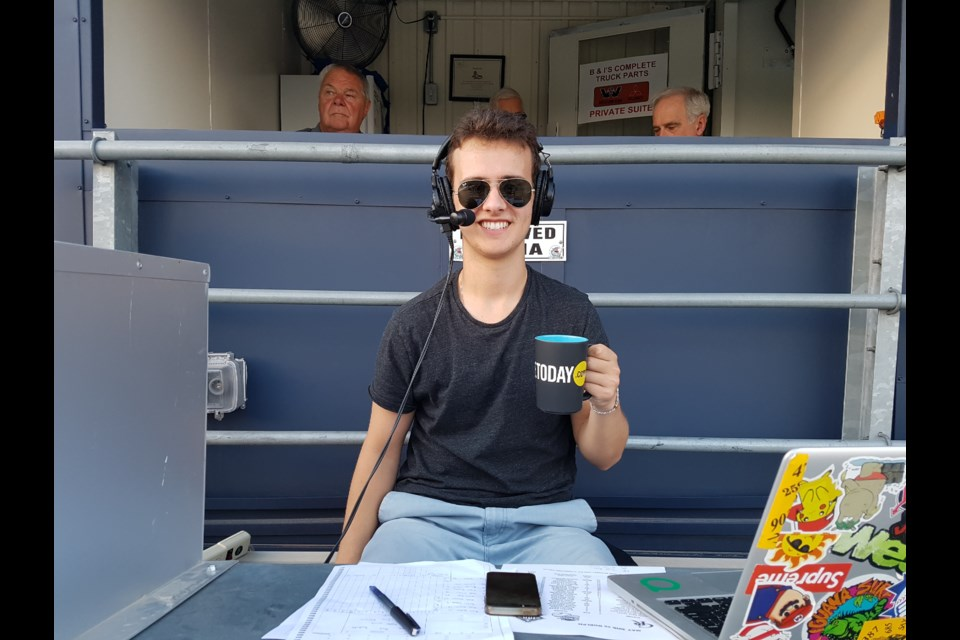 Ben Shulman about to call the Barrie Baycats game takes time out to be mugged by Barrie Today. Shawn Gibson for BarrieToday