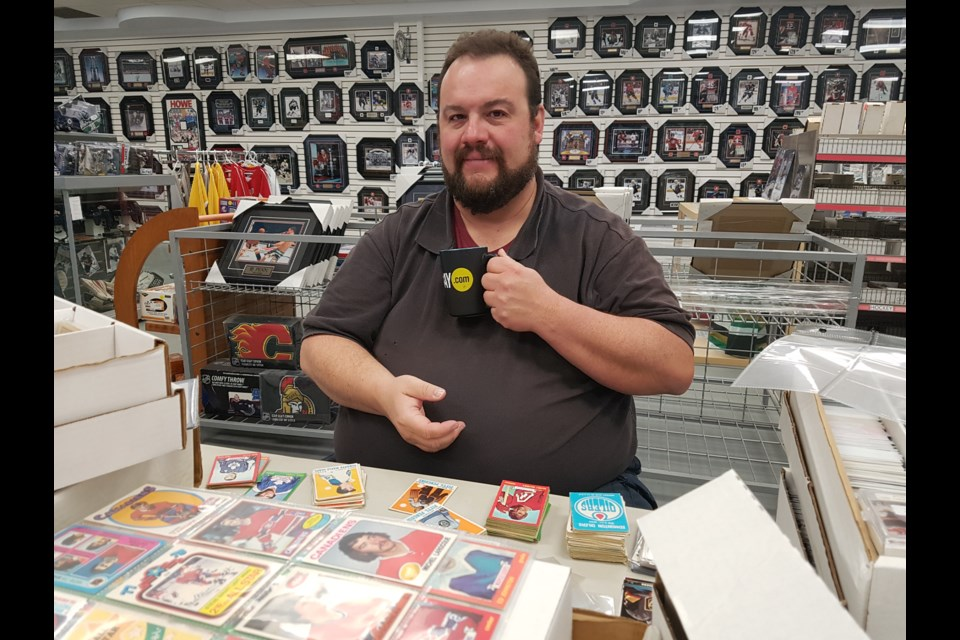 Wayne Frazer enjoys his BarrieToday mug and his hockey cards. Shawn Gibson for BarrieToday
