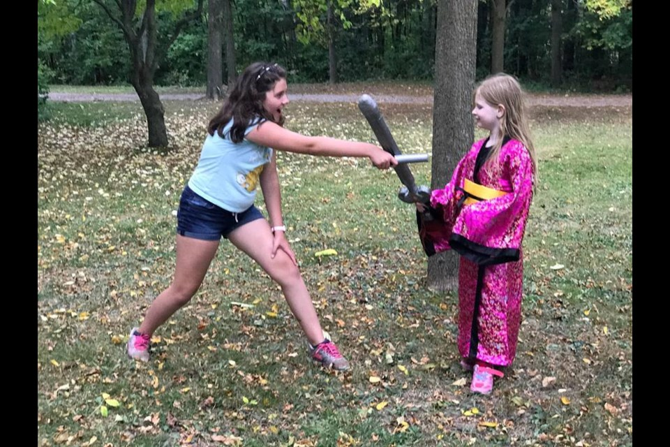 Two children enjoy social play during a LARPing field trip. Shawn Gibson for BarrieToday