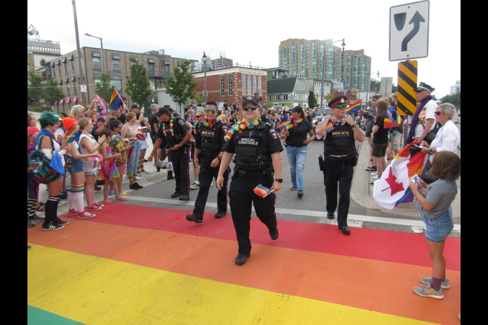 The Barrie Police were cheered as they approached the rainbow crosswalk at Saturday's Barrie Pride Parade. Shawn Gibson/BarrieToday