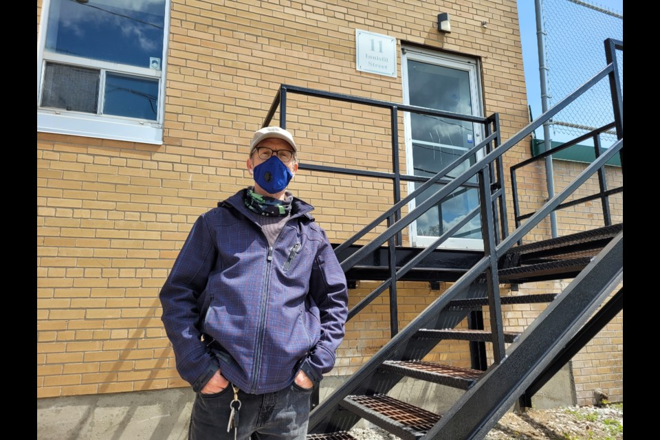 David Moore stands outside the location to where the proposed SCS could be located, at 11 Innisfil St.
