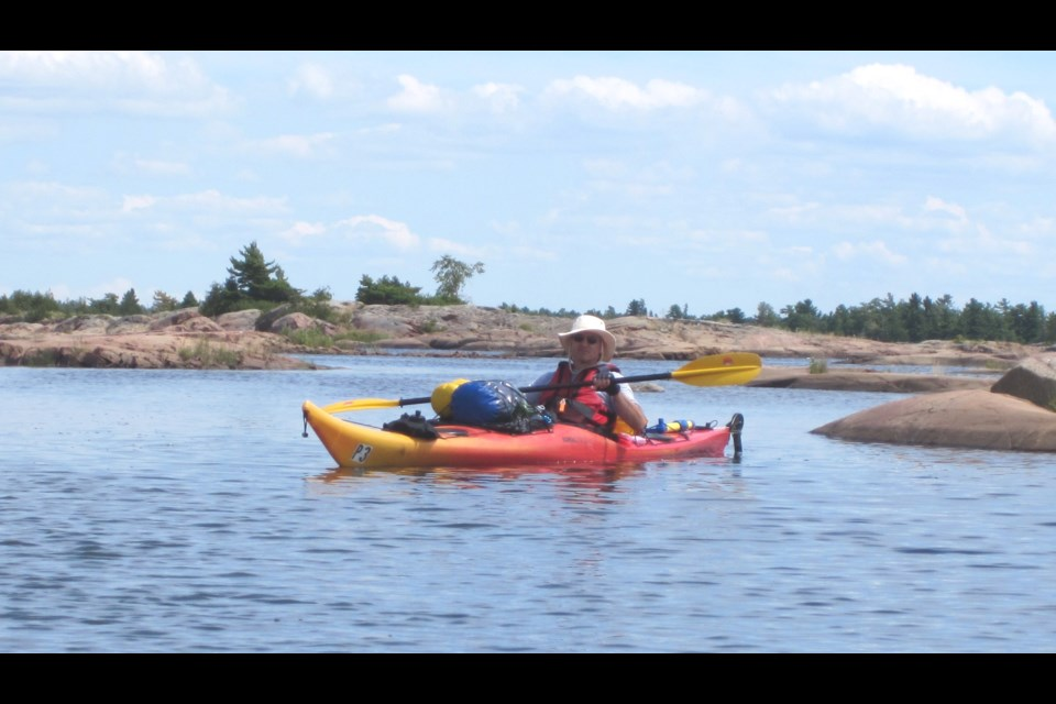 BarrieToday reporter Bob Bruton kayaking near the shores of Georgian Bay, loaded with gear... and beer.