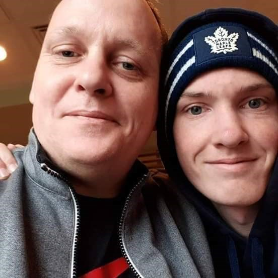 Alex Milnes, left, and his son Jaiden Milnes enjoyed watching sports together. Jaiden drowned Tuesday at Wasaga Beach. Photo supplied
