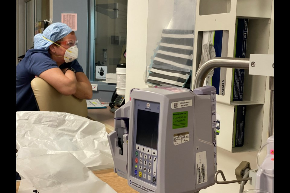 An ICU nurse takes a quick break during a shift at Barrie's Royal Victoria Regional Health Centre while caring for COVID-19 patients.