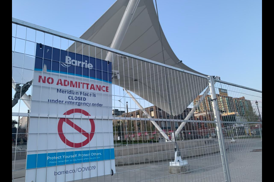 Fencing was erected around Meridian Place in downtown Barrie. in May to help prevent gathering of crowds. The fence will be removed Friday as part of the province's reopening plans.