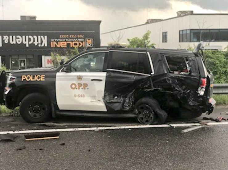 Provincial police are investigating after a vehicle slammed into an OPP vehicle on Highway 400 northbound, Tuesday.