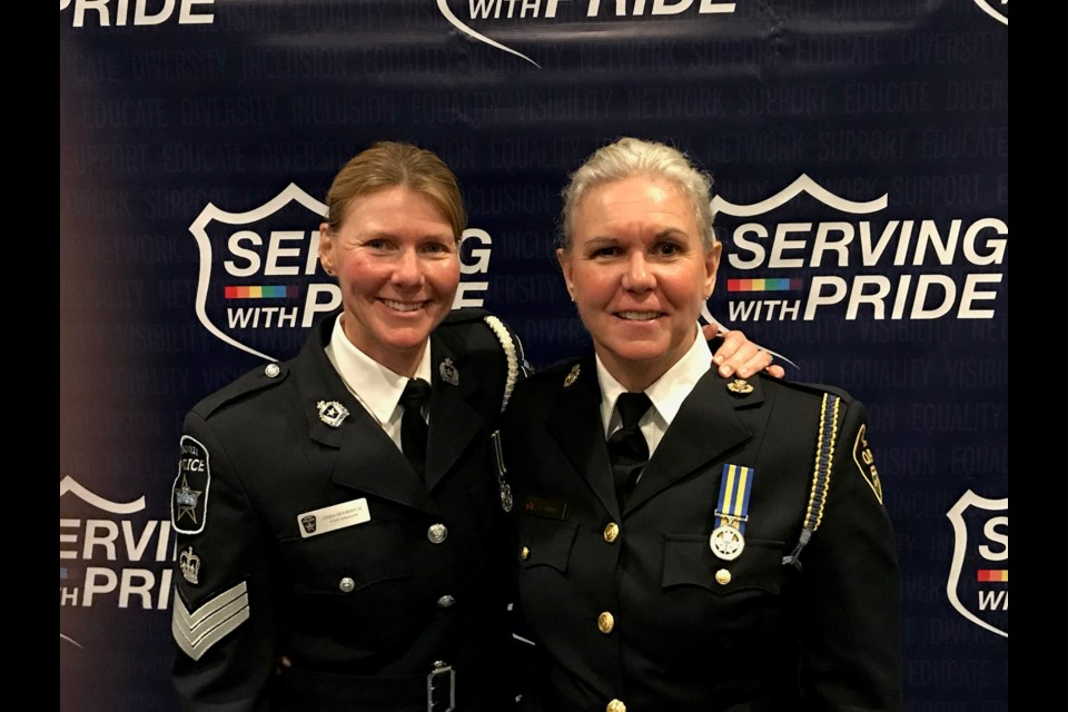 Barrie police Staff Sgt. Linda Moorhouse (left) and her wife, OPP Sgt. Valerie Burns, are shown at a Serving With Pride Gala.