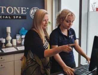 Barrie's Hand and Stone owner Ailene MacDougall (left) is excited about the company's new health-care worker promotion.