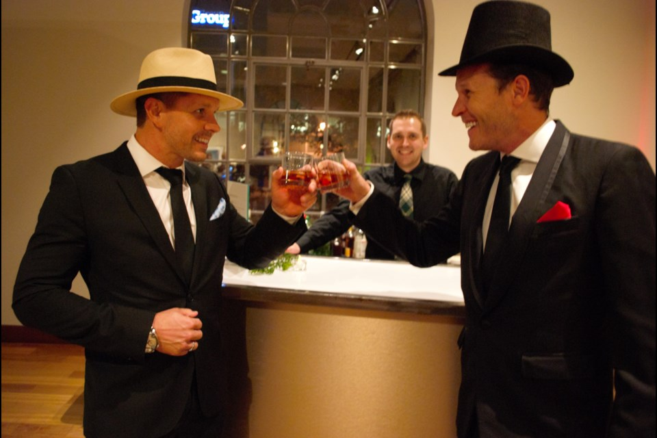 Left, Marc Pumple and Phillip Moore toast to luck at the MacLaren Speakeasy and Poker Tournament on Thursday night. Jessica Owen/BarrieToday