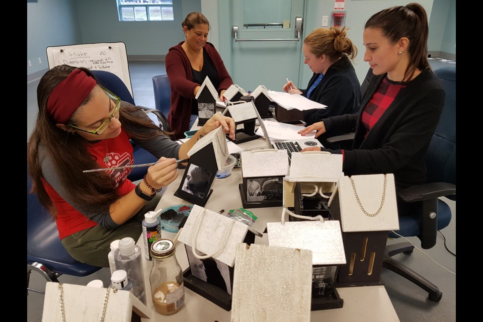 From left, Crystal Blakey-Kellare, Sara Peddle, Sandra Best and Stacey Daoust put the finishing touches on items for the Street Light Gala set for Friday night. Shawn Gibson/BarrieToday