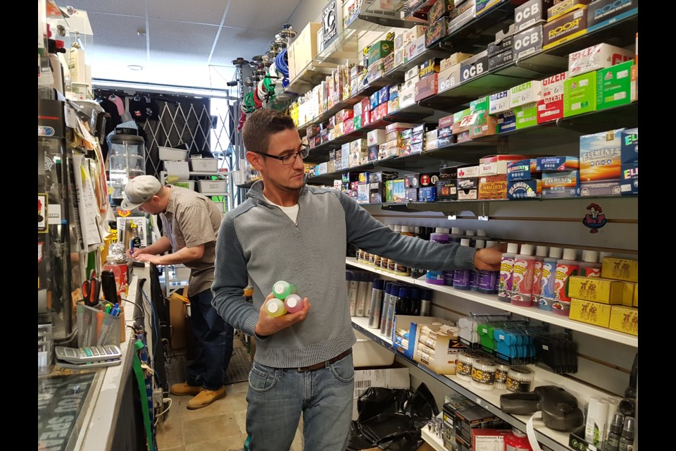 Eric Batters stocks the shelves at Liquid Chrome. Shawn Gibson/BarrieToday
