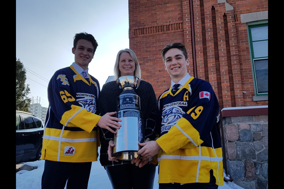 From left, Nicholas Dowlings, Liz Grummett and Cole Quevillon pose with the Start Talking Cup. Shawn Gibson/BarrieToday