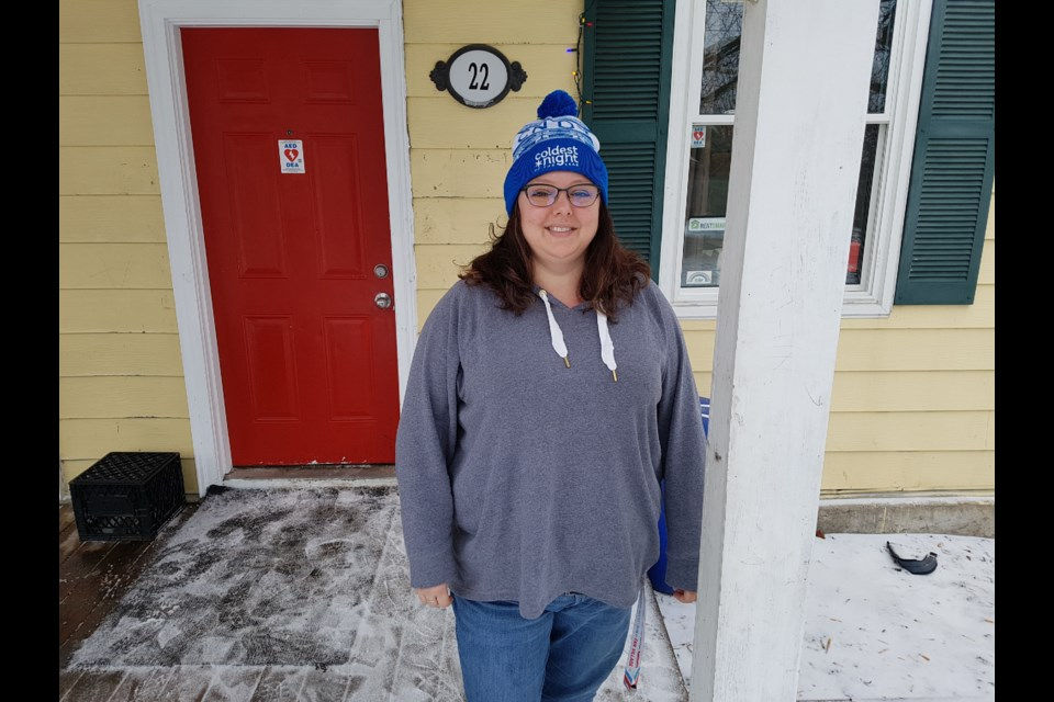 Nicole Barkley wears the CNOY toque outside Barrie's Youth Haven. Shawn Gibson/BarrieToday