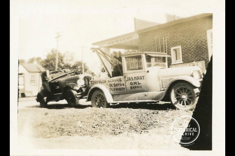 A wrecking car belonging to the Hart Garage on Bradford Street in 1930.
