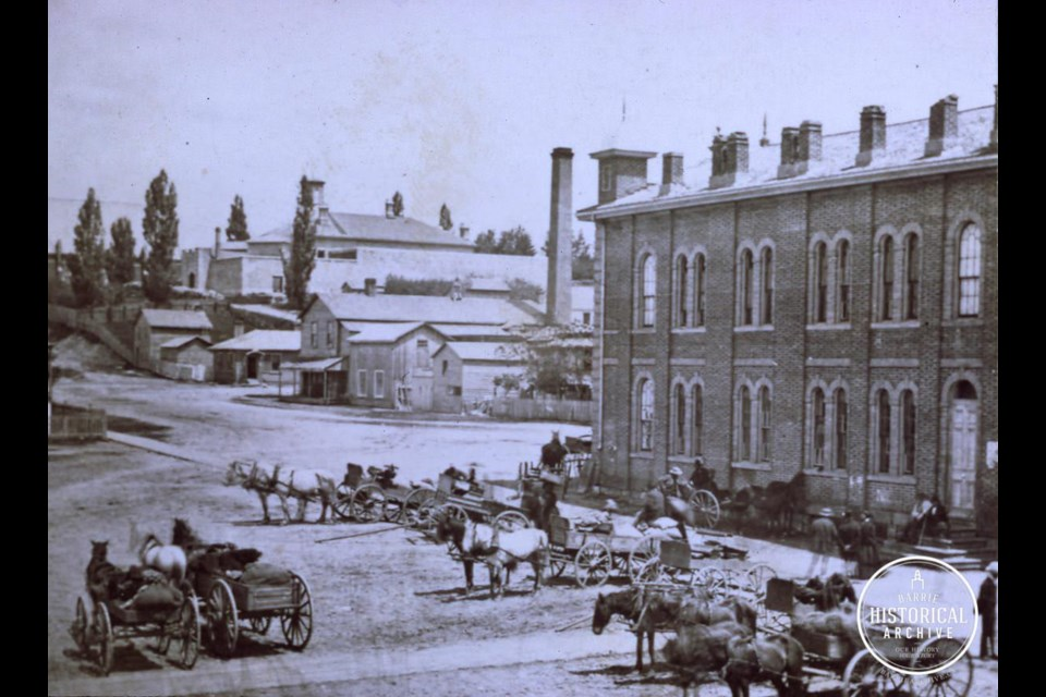 Market Square, later City Hall, (now the green arch) looking up Mulcaster St. to where the old jail still sits today.