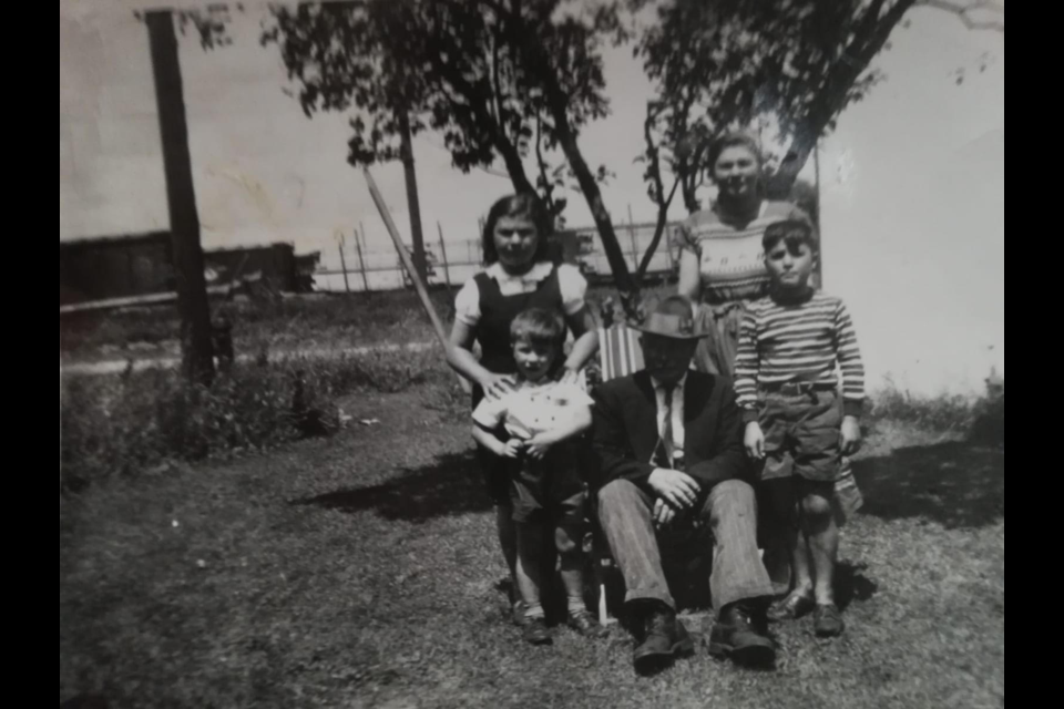 Antonio 'Mr. Tony' Curcio is surrounded by four of his grandchildren, Guido, Angela Maria, Wanda and Francesco Antonio De Simone. The photo was taken on the lawn of 89 Gowan St. with the railway lands and lake behind them. Photo courtesy of the Barrie Historical Archive