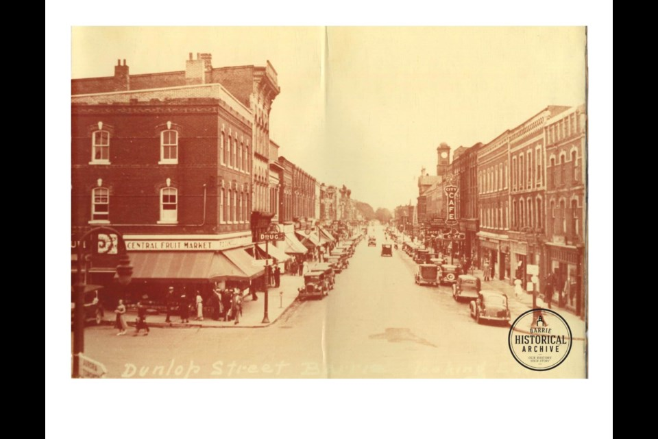 Dunlop St. looking east from Five Points. Notice the 'Shoes' sign part way down the right hand side. Circa 1920. Barrie Historical Archive