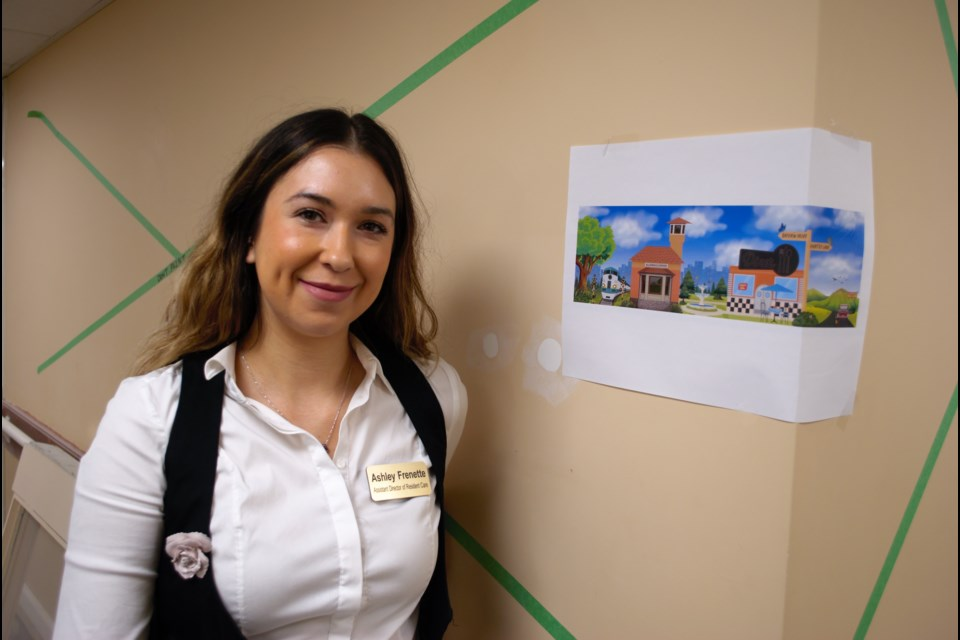 Ashley Frenette, assistant director of resident care at IOOF Seniors Homes, shows a print out of the mural of Allandale Train Station. Jessica Owen/BarrieToday