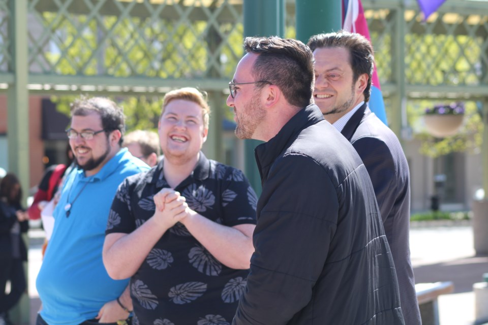 From left, Carl LeMesurier, Caleb Kenehan, Barrie Mayor Jeff Lehman and Coun. Keenan Aylwin attend a ceremony marking International Day Against Homophobia, Transphobia, and Biphobia on May 17, 2019. TransQ hosted a flag-raising ceremony and walk in downtown Barrie. Raymond Bowe/BarrieToday