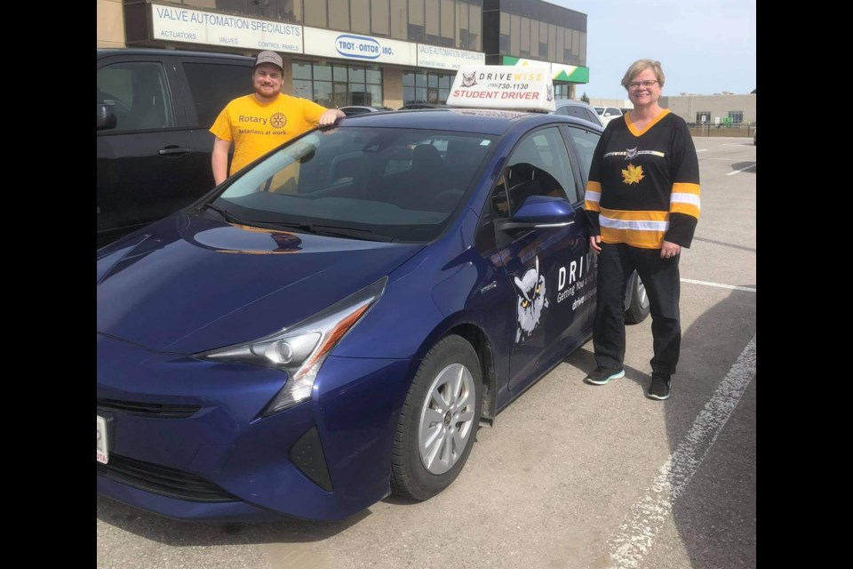 Dylan Henry (left) and Lesley De Repentigny have the car ready and are looking to lend a hand in the COVID-19 health crisis. Photo submitted