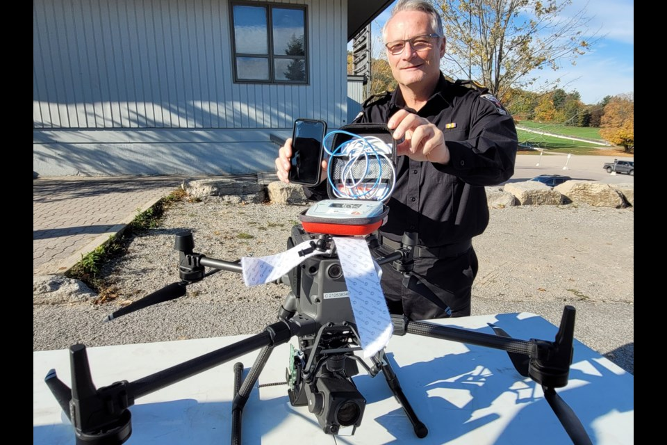 County of Simcoe Paramedics Chief Andrew Robert poses with the Matrice 300 drone used in a mock life-saving demonstration on Thursday at Horseshoe Resort in Oro-Medonte Township.
