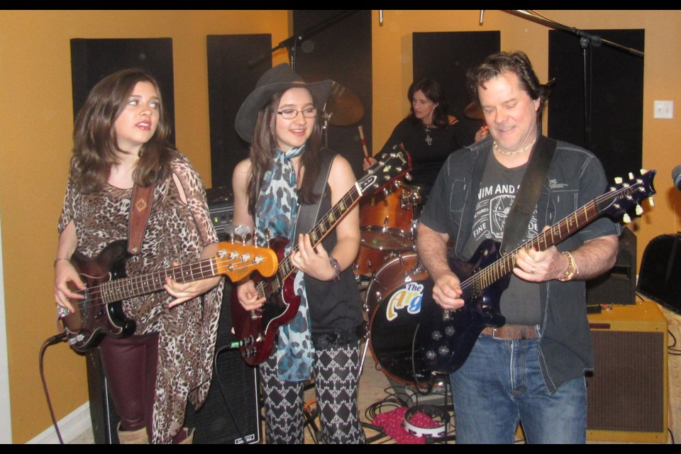 The Argues live in the practice space. Photo by Shawn Gibson for BarrieToday.