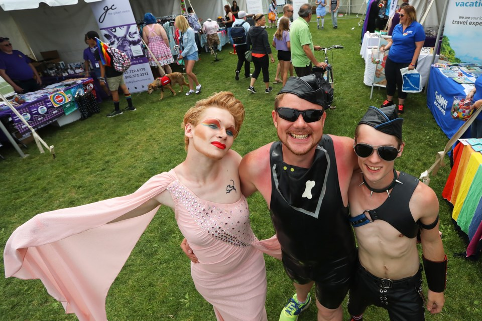 Kevin Haycock, David Knott, and Winston Langley welcome visitors to the Barrie Pride festivities held along the lakeshore on Saturday, June 9, 2018. Kevin Lamb for BarrieToday.