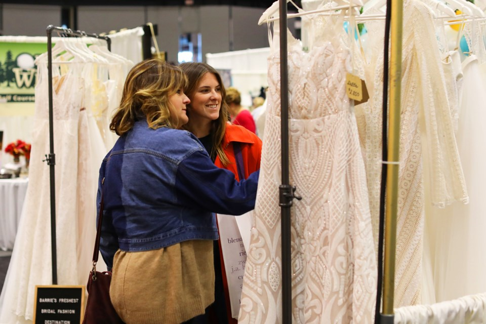 Samantha and Barbara White look over dresses at the Simcoe County Bridal Show held at the Molson Centre in Barrie on Saturday, October 20, 2018. Kevin Lamb for BarrieToday.
