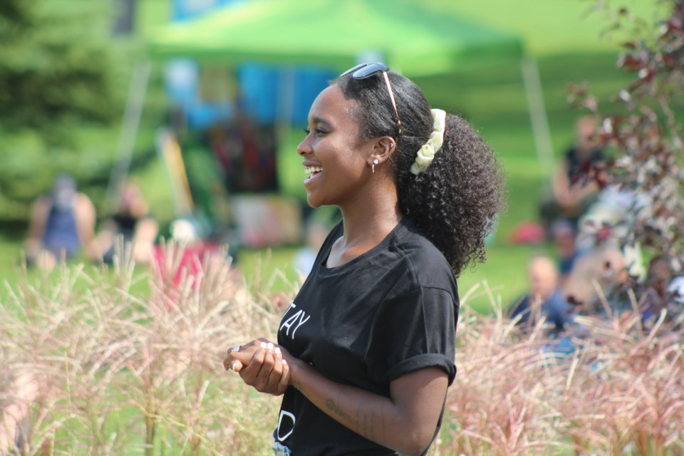 Shanicka (Shak) Edwards listens to a speaker during a recent Black Lives Matter rally at Sunnidale Park in Barrie. Raymond Bowe/BarrieToday File Photo