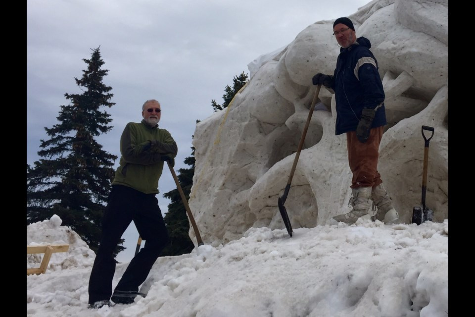 Snow sculptors Mark Goger and Siggi Buhler are making a mountainous creation for Winterfest.  Sue Sgambati/BarrieToday