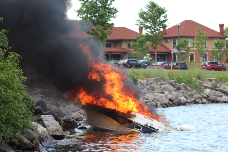Barrie firefighters battle a boat fire after it re-ignited along the shore of Kempenfelt Bay on Canada Day. Raymond Bowe/BarrieToday