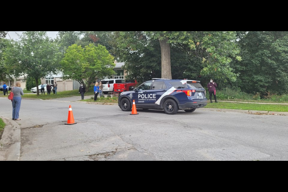 """A Barrie police officer speaks to a Georgian College staff member who was monitoring the Cook Street entrance to the school grounds after a lockdown was put in place Tuesday morning due to """"suspicious activity."""""""